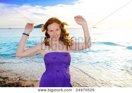 Dancing girl at Ibiza sunset in Cala Conta of San Antonio chillout