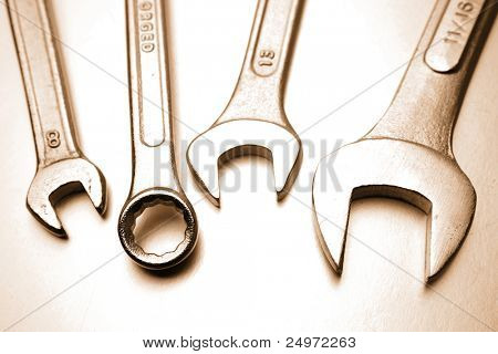 Closeup of spanners on plain background