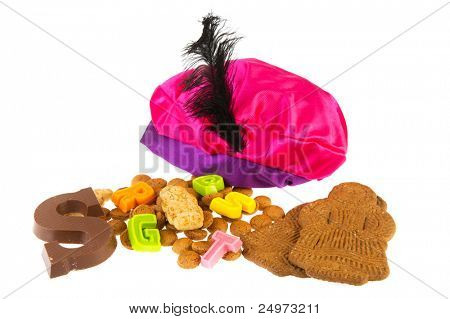 Dutch Sinterklaas candy as pepernoten and chocolate letter with hat of Black piet