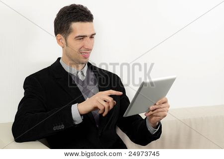 Businessman Using A Touch Screen Tablet