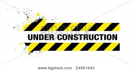 abstract grunge under construction sign with splats