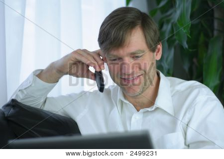 Handsome Businessman With Cell Phone And Laptop