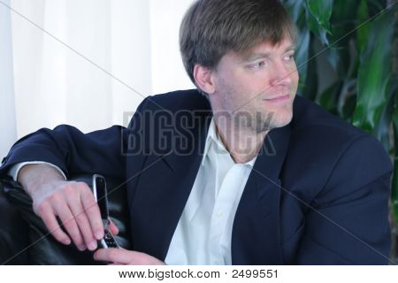 Handsome Businessman Using Cell Phone.