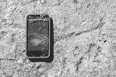 Broken Smartphone. Smartphone With Broken Screen On Concrete Background poster