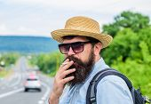 Cigarette Before Long Journey. Traveler Stylish Hipster Take Brake.man With Beard And Mustache In St poster