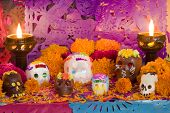 stock photo of sugar skulls  - Mexican Day of the dead altar created entirely for this image session - JPG