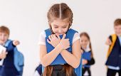 Children bullying their classmate on light background poster