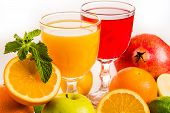 Ripe Fruit And Juice. Glasses Of Juice And Fruits Isolated On White. poster