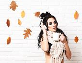 Autumn Club Party With Dry Leaves Decor. Hot Drink And Club Concept. Girl With Romantic Face Holds C poster