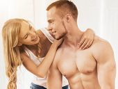 Guy With Naked Torso With His Smiling Cute Wife. Happy Family Relationships. Family Idyll. Establish poster