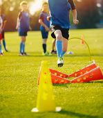 Kid Young Athletes Training With Football Equipment. Football Speed Training. Young Footballer In Bl poster