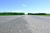 Empty Asphalt Road With A Dividing Strip, Passes Through A Blooming Green Agricultural Field And For poster