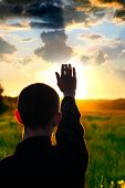 picture of rapture  - young man silhouette on sun set background - JPG