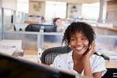 Young black woman working in a call centre poster