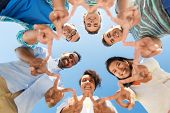 people, friendship and international concept - group of happy smiling friends outdoors standing in c poster