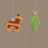 stock photo of pinata  - pinata and cactus hanging mexican decorations with copy space - JPG