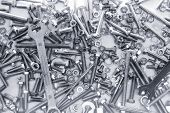 Background Of Many Different Metal Rivets, Screws And Bolts Of Silver And Black Color poster