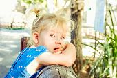 Close Up Portrait Of Bondy Toddler Girl With Beautiful Blue Eyes With Tears In The Park. Child Feeli poster
