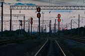 railroad traffic lights and infrastructure during beautiful sunset, colorful sky, transportation and poster