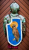 foto of paladin  - Knights old iron armour hanging on the wooden door - JPG