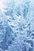 Frost rime patterns on window glass in winter. Frosted Glass Texture. Blue background. poster