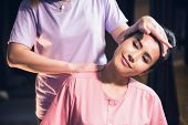 Portrait Of Relaxed Asian Beautiful Woman Massaging Neck And Shoulder By Professional Massager In Sp poster