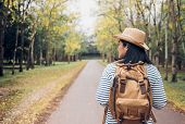 Back Of Young Traveler Woman Backpacker Looking Forward At Forest In Autumn Season,freedom Wanderlus poster