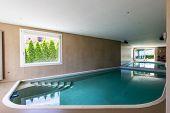 Indoor pool in modern villa just renovated. Nobody inside poster
