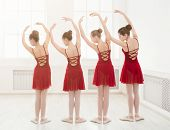 Young Girls Dancing Ballet In Studio. Choreographed Dance By A Group Of Graceful Pretty Young Baller poster