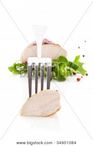 Juicy Chicken Piece On Fork.