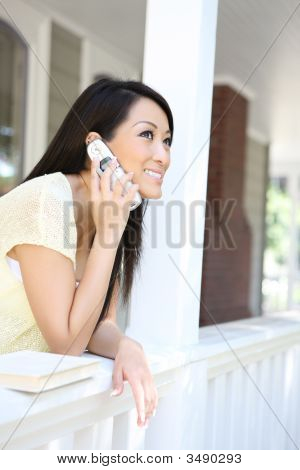 Pretty Asian Girl On Phone At Home