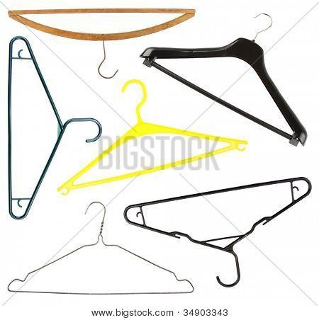 Assorted coat hangers isolated on plain background