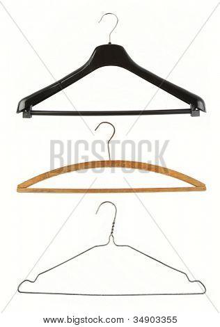 Three coat hangers isolated on plain background