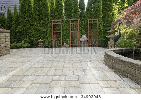 Backyard Paver Patio With Pond And Garden Decoration