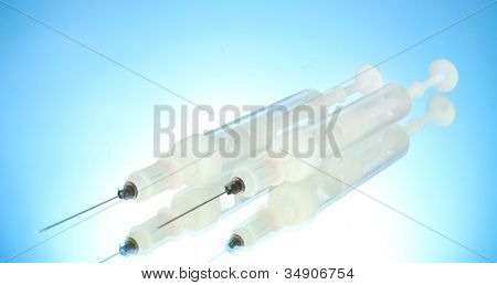 syringes monovet on blue background