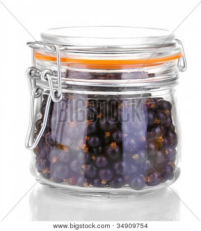 Black currant in glass isolated on white