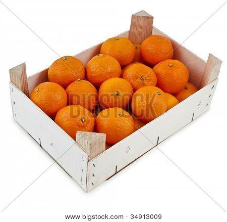 ripe orange mandarines in wooden box isolated on white