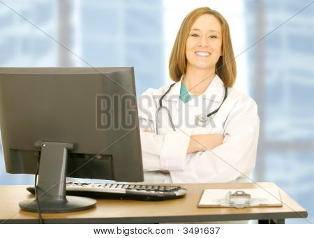 Doctor Woman Sitting On Her Desk