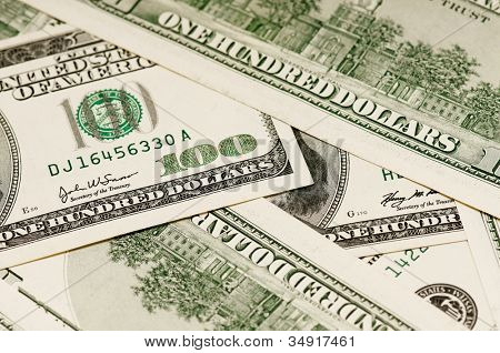 Money background, heap of dollars, financial concept of earnings