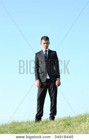 Business man standing in nature