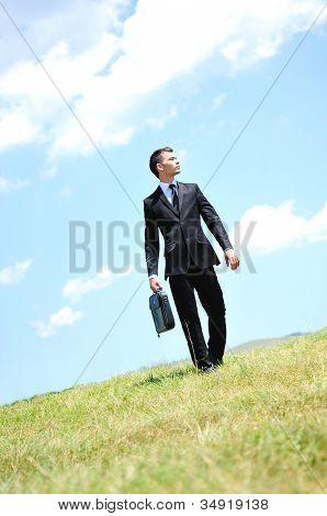 Business man walking in nature