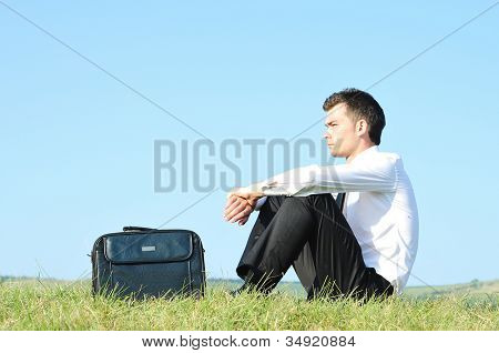 Business man standing upset in nature