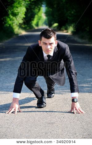 Business man start running on road