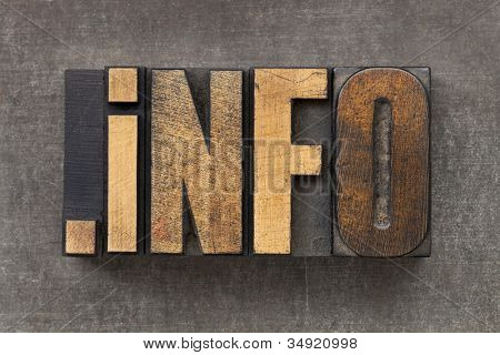 dot info  - internet domain for information resources in vintage wooden letterpress printing blocks on a grunge metal sheet