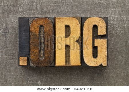 dot org - internet domain for nonprofit organization in vintage wooden letterpress printing blocks on a grunge metal sheet
