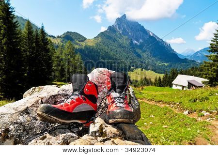 red hiking boots for a hike in the mountains of austria. activity during leisure time