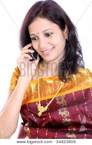 Happy Traditional Young Woman Talking On Mobile