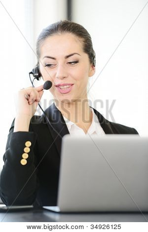 Female call centre employee speaking over the headset