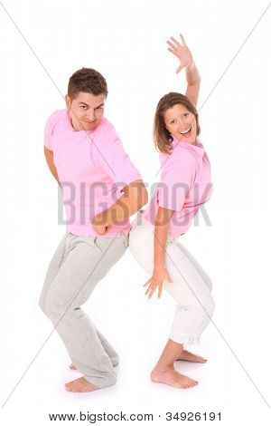A picture of a young happy couple posing over white background