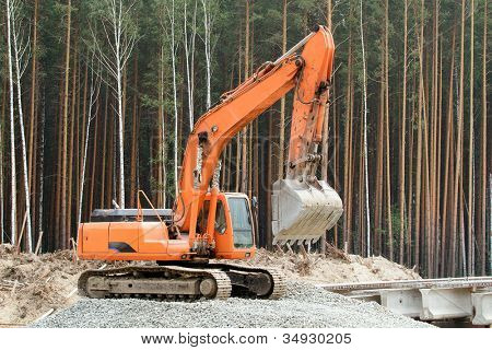 Heavy earth mover in the forest